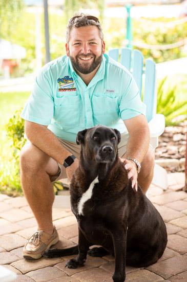 Adam Botana with his dog